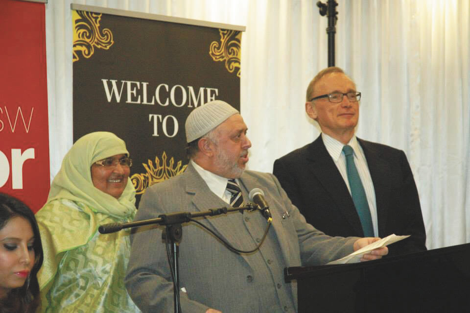 Mehar and Zia Ahmad presenting AMUST framed memorabilia to Bob Carr