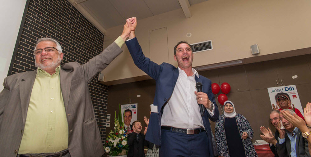 Jihad Dib with his parents after winning the seat of Lakemba