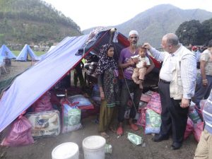 Bashar Al-Jamal distributing aid from Human Appeal International Australia to the victims of the Nepal earthquakes who are sheltering in makeshift tents.