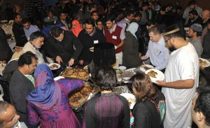 Food rush at the University of Western Sydney Iftar. (Photo by David Marshall)