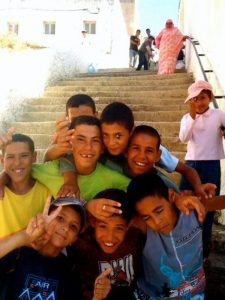 Young boys embrace each other for a photo (Tangier, Morocco)