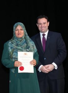 Dunya Alruhami (Iraq) with Minister Ayres for Higher Education Award.