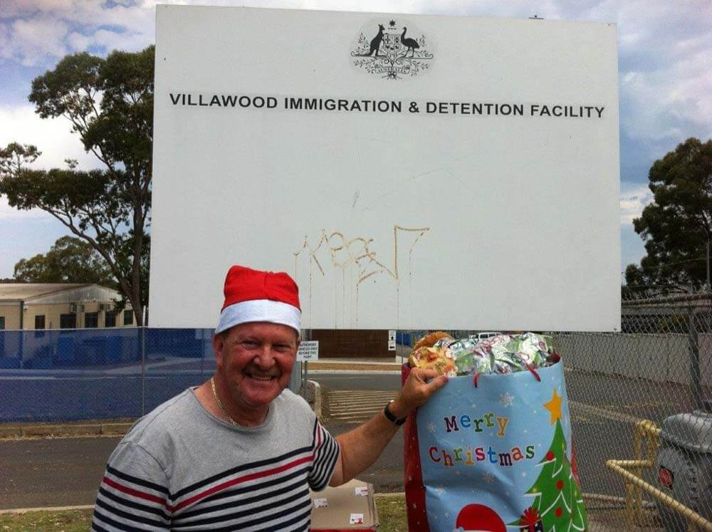 P10_Philip Feinstein delivering presents at Villawood last year