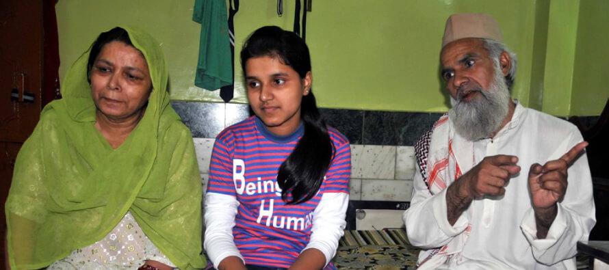 Imam's daughter breaks record in top school