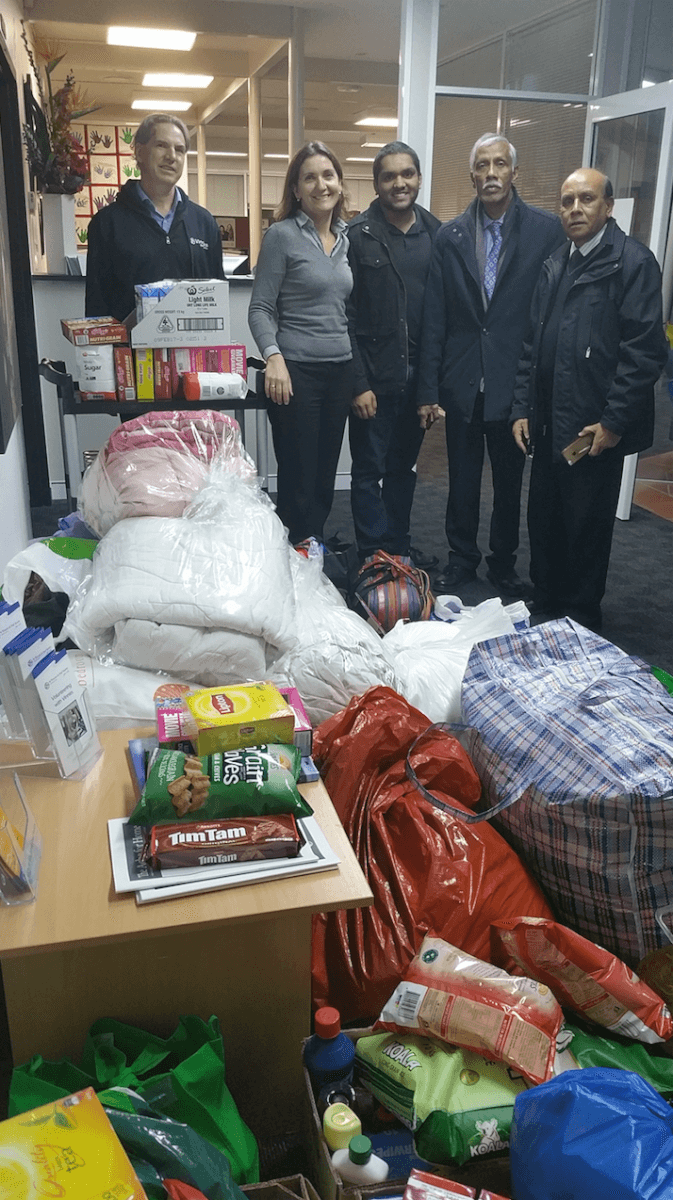 Paul Trezise (left) with Anneloes de Graeff of Vinnies with Afzal Ahmad, Borhan Ahmed and Mohammed Ali with the donated goods.