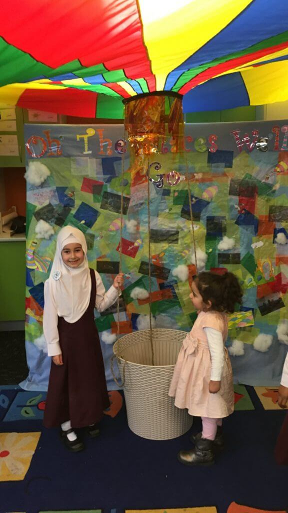 "Esma Sure Yoldas, 6, Class 1B with her younger sister Nisa Gul Yoldas, 2 at the ""Our Global Village"" Exhibition at Al Siraat College."