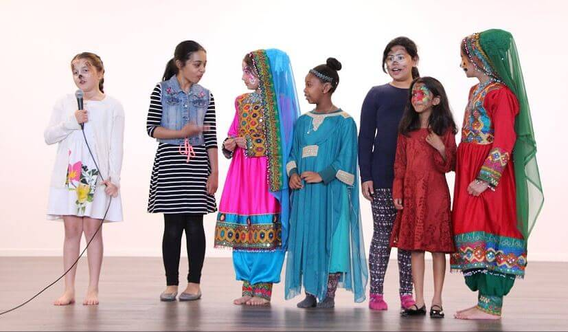 Children perform their play at the festival