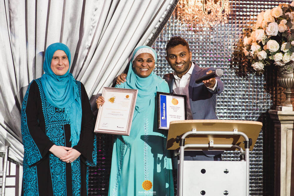 Nazeem Hussain (right), winner of the 'Creative Artist of the Year' award with his mother and Hanan Dover (left), Trustee of Mission of Hope.