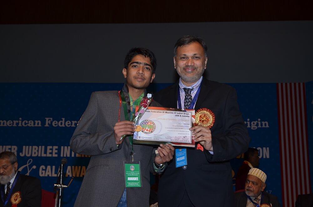 Dr Habib Bhurawala awarding prize to AFMI medal recipient student.