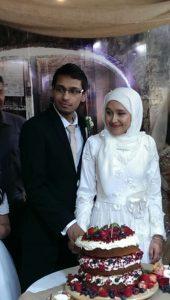 Asiful Islam and Zeynab Gamieldien cutting the cake.